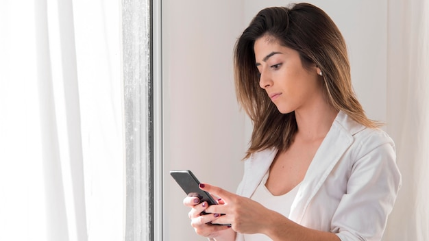 Medium shot woman with phone