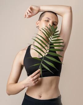 Medium shot woman with plant