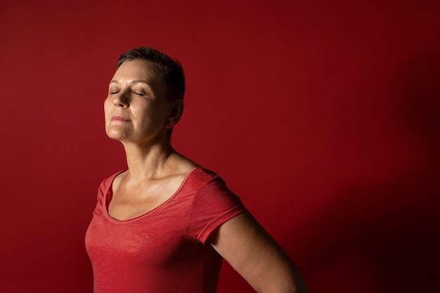 Medium shot woman with red background