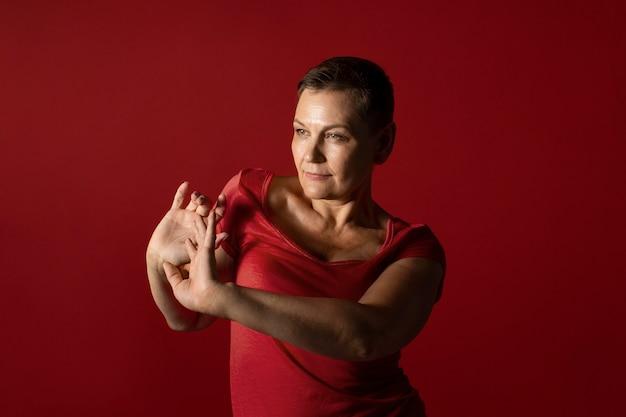Medium shot woman with red dress