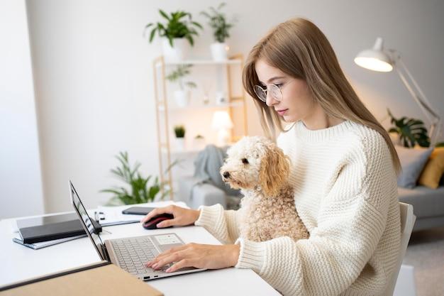Medium shot woman working with dog