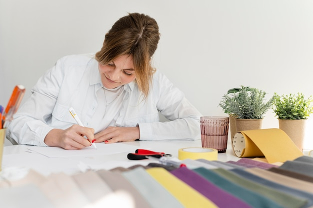 Medium shot woman writing