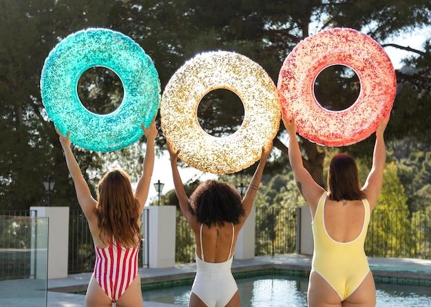 Medium shot women in bathingsuits