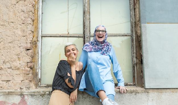 Medium shot of women laughing