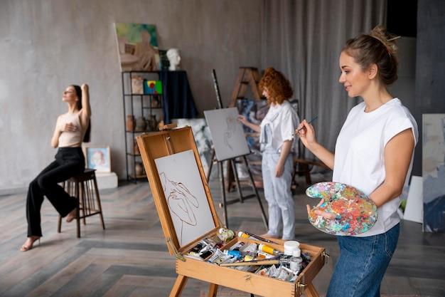 Medium shot women painting