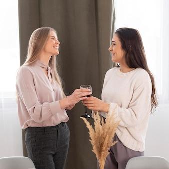 Medium shot women with glass of wine