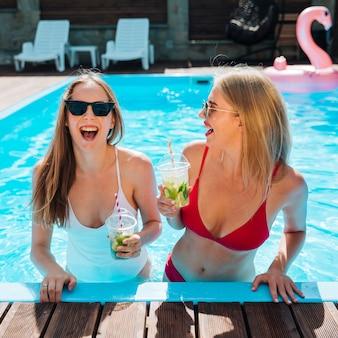 Medium shot young women laughing