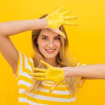 Medium show woman with paint on hands