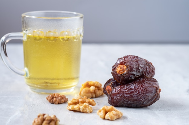 Medjool dates and walnuts on marble floor it is a highly useful food