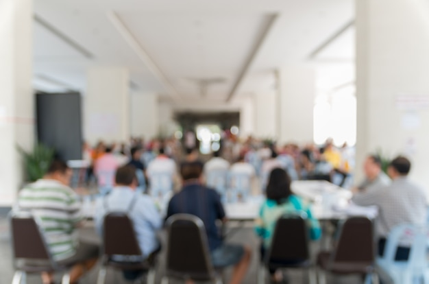 Meeting blurred background at bright conference hall