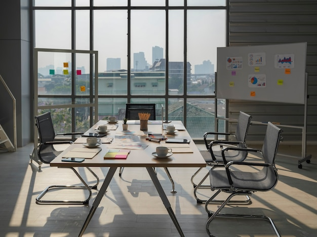 Meeting table and chairs, conference room in modern office with window and city view