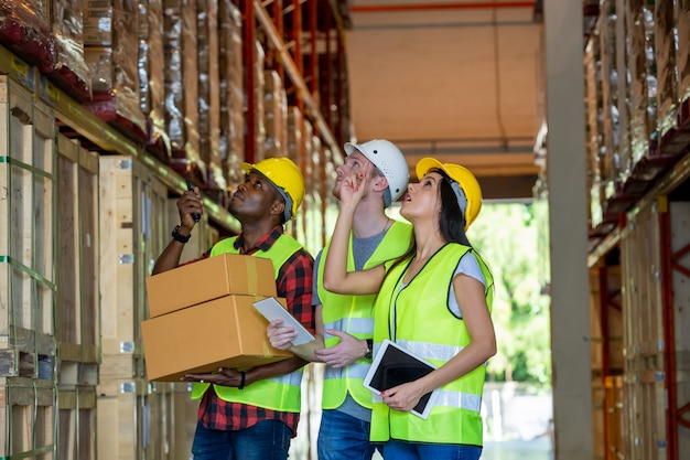 Meeting at warehouse,warehouse workers working together at warehouse.
