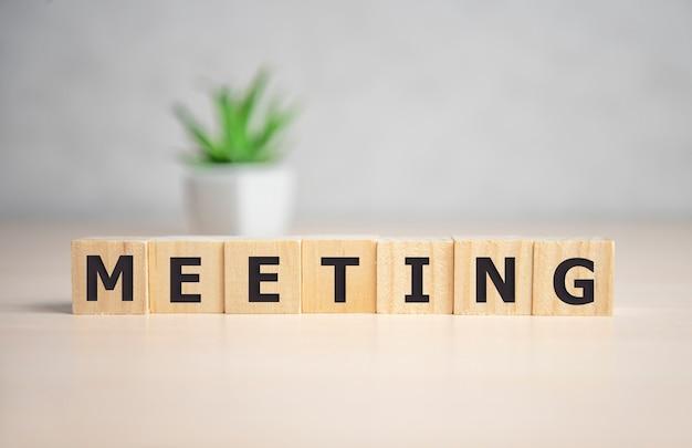 Meeting word written on wood block