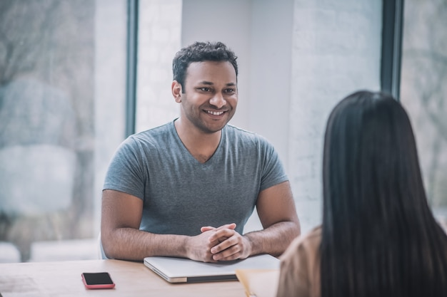 Meeting. a young businessman meeting a female client