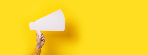 Megaphone in hand, attention advertisement concept