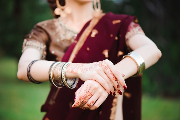Mehndi tattoo. woman hands with black henna tattoos. india national traditions.