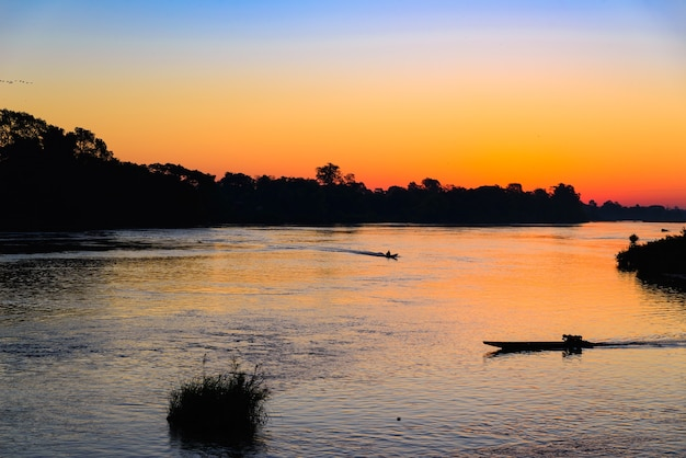 Mekong river 4000 islands laos, sunrise dramatic sky, mist fog on water. south east asia Premium Photo