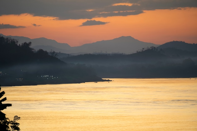 Mekong river view in the evening with foggy twilight sunset sky at chiang khan, loei, thailand