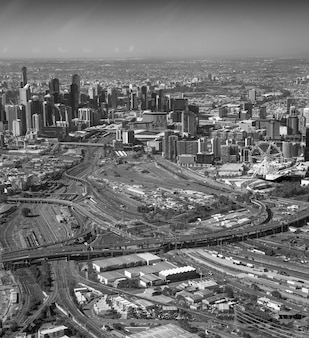 Melbourne aerial city view with skyscrapers, railway and interstate road.