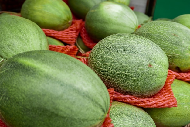 Melon placed for sale on booth at market.
