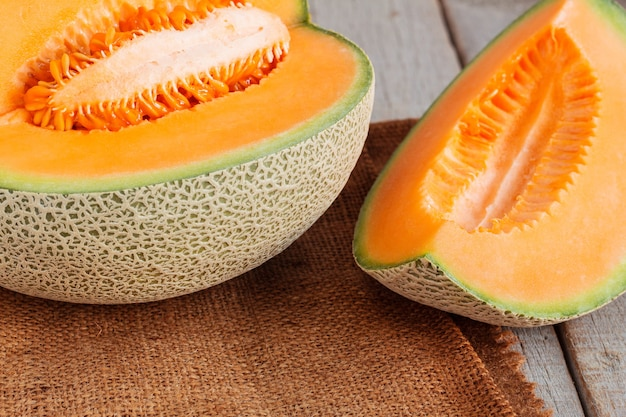 Melon sliced on wooden