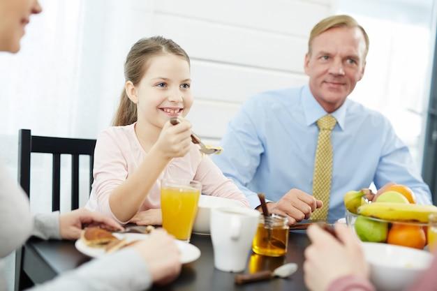 Members of lovely family having breakfast