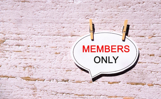 Members only on a white bubble speech paper with wooden pins