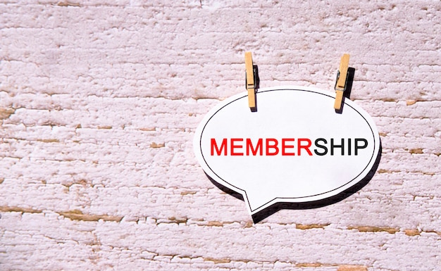 Membership on a white bubble speech paper with wooden pins