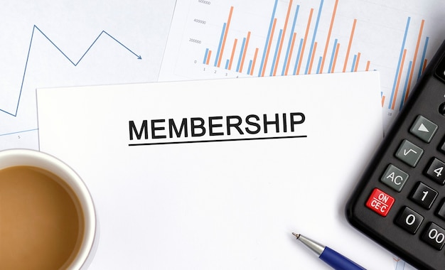 Membership with graphs, diagrams and calculator and a cup of fragrant coffee