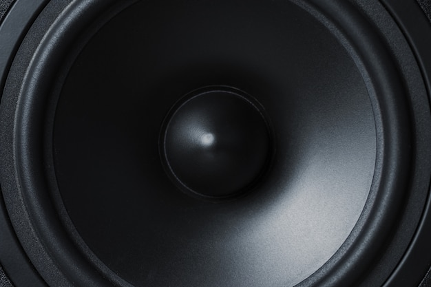 Membrane sound speaker on black, close up