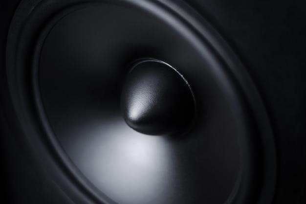 Membrane sound speaker on black, close up