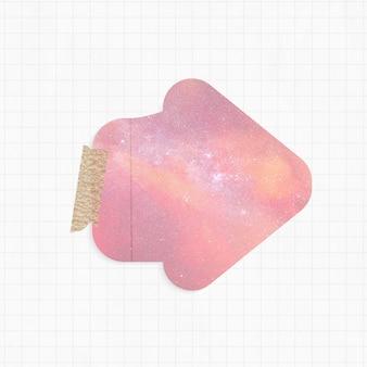 Blocco note con forma di freccia sullo sfondo della galassia rosa e nastro washi