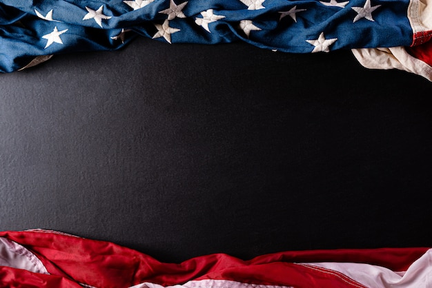 Memorial day. american flags against a black  wall