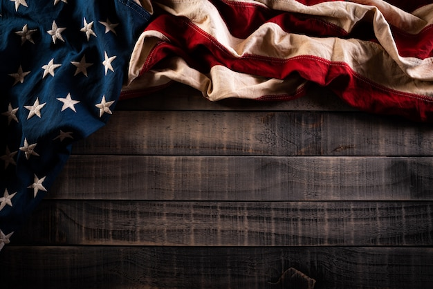 Memorial day. american flags against an old wooden wall