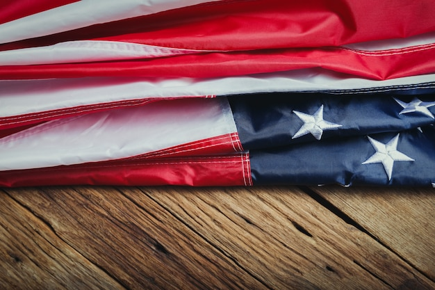 Memorial day or independence day  concept made from american flag on old wooden background.