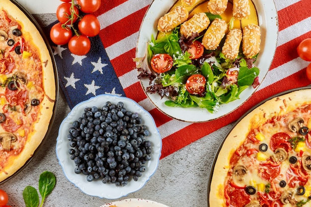 Memorial day party table with delicious food for american holiday.