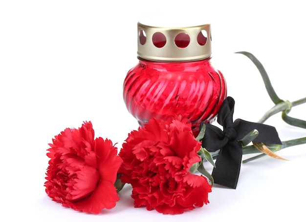 Memory lantern with candle, carnations and black ribbon isolated on white