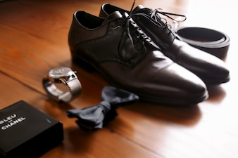 Men accessories laid out on wooden floor