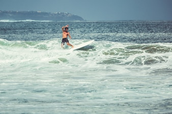 Men and girls are surfing