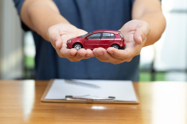 Men are choosing to buy and sign contracts policy with vehicle and car insurance, protection of car concept
