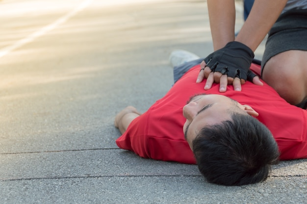 Men are doing cpr for a friend who has a heart attack