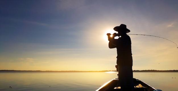 Men are fishing in the marsh.