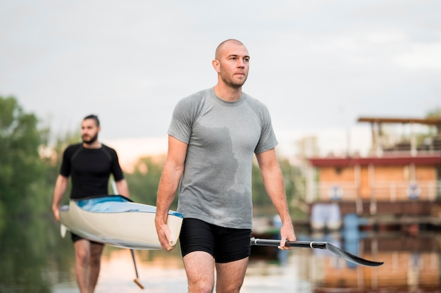 Men carrying a canoe