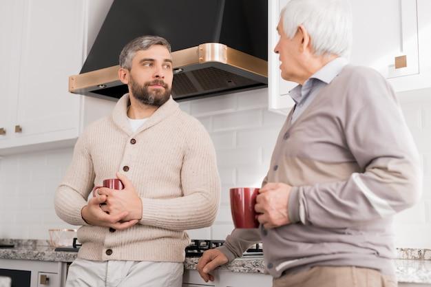 Men chatting in kitchen