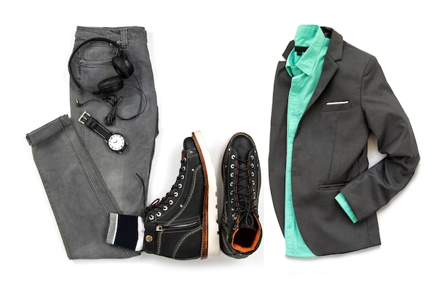 Men clothing set  with black ankle boot , watch, earphone gray jeans and gray suit isolated on a white background, top view