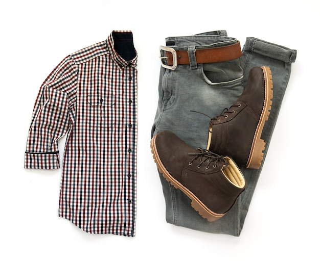 Men clothing set with brown boots, belt, shirt and gray jeans isolated on a white  background. top view