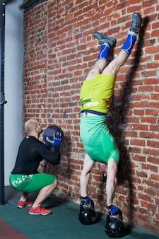 Men doing handstand