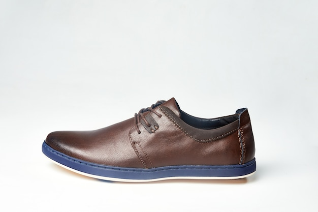Men fashion brown shoe leather over white background. casual stylish footwear.
