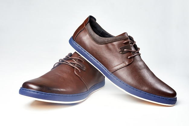 Men fashion brown shoe leather over white background. pair casual stylish footwear.