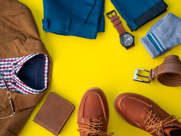 Men fashion clothing set and accessories isolated on a yellow. office clothes concept, top view